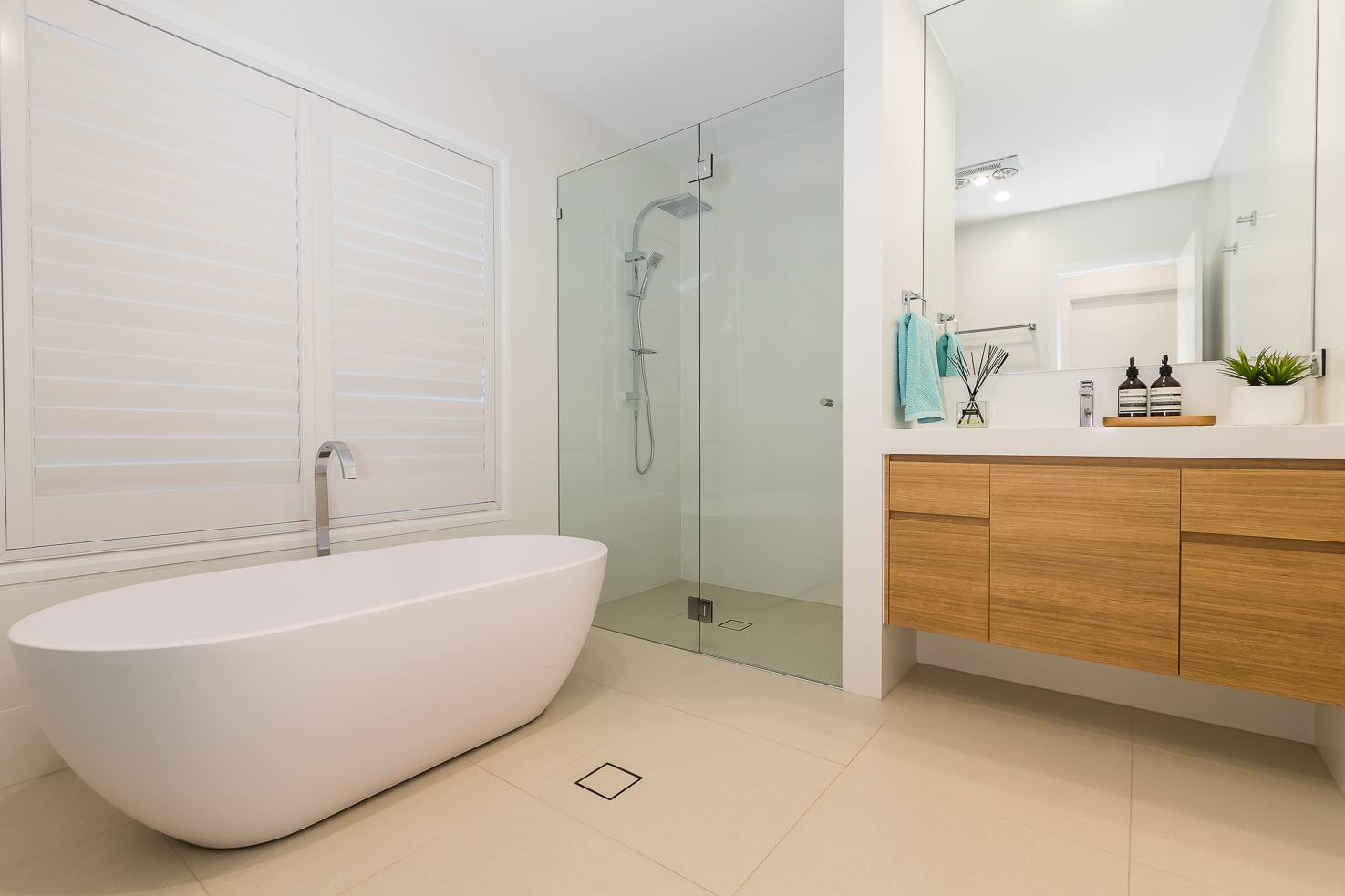 Brisbane Manly contemporary home by evermore main bathroom with freestanding bath