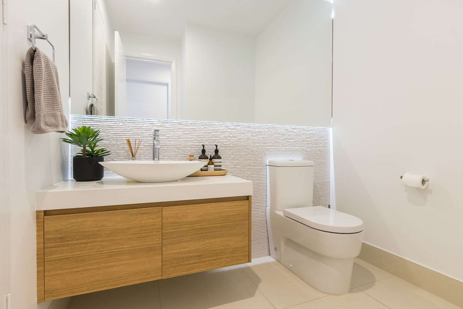 Brisbane Manly contemporary home view of the powder room with feature tiles