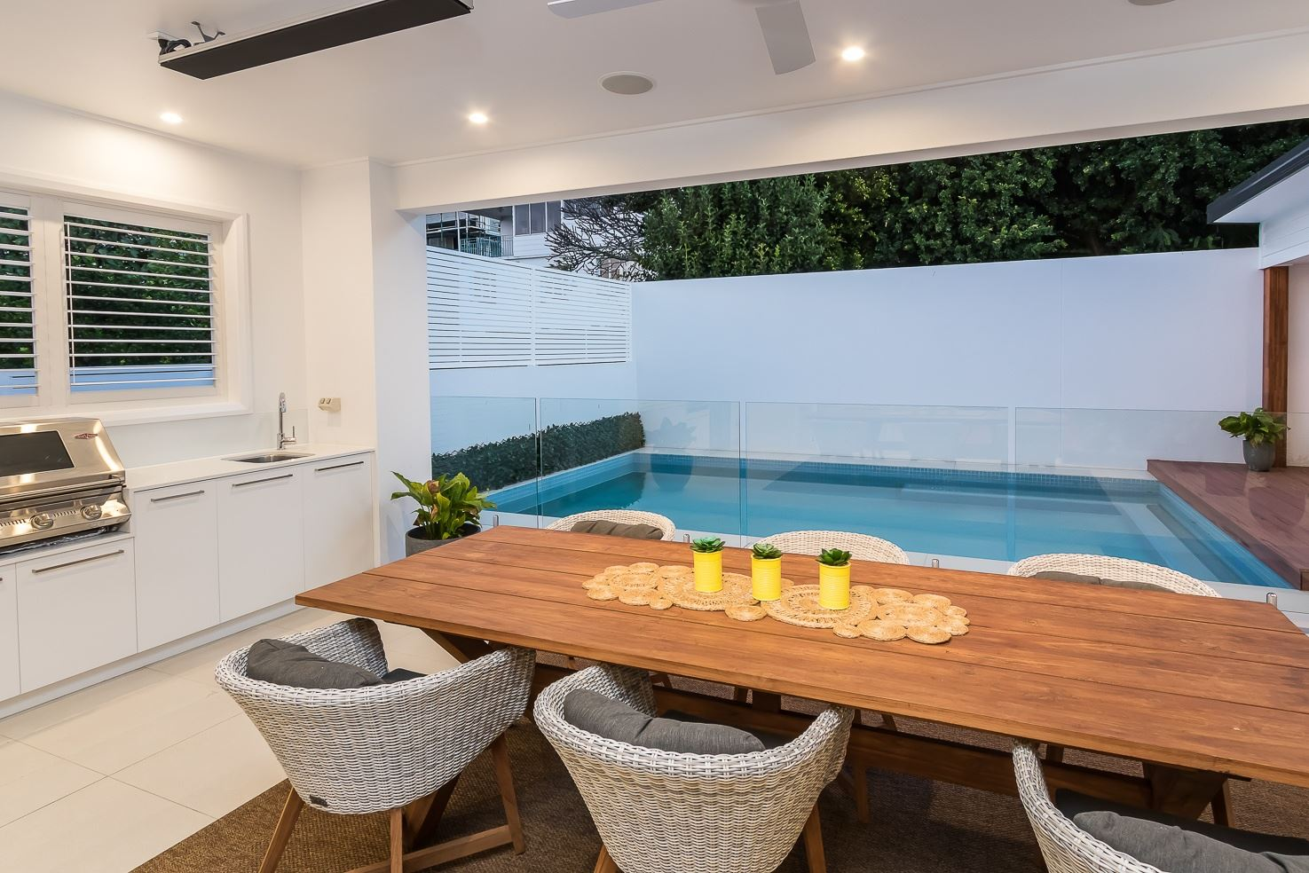 Brisbane Manly contemporary home by evermore overlooking the pool from the entertaining area