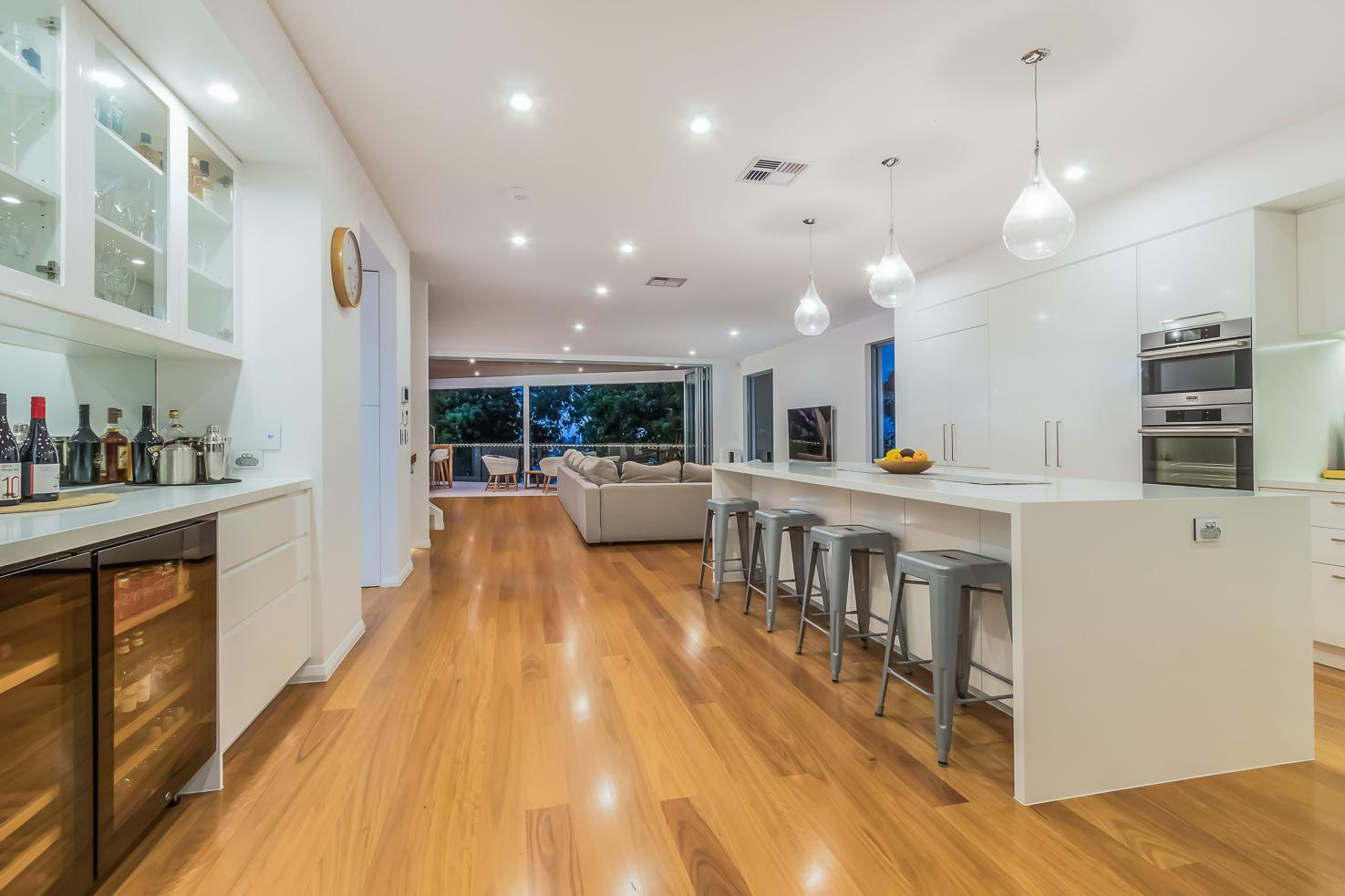 Brisbane Manly contemporary home by evermore looking from the kitchen to the view on the front deck