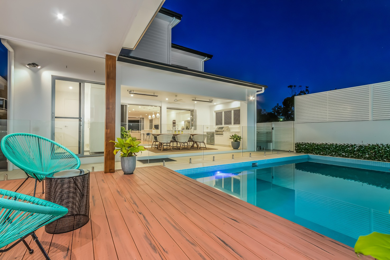 Brisbane Manly contemporary home back view of the pool area at dusk