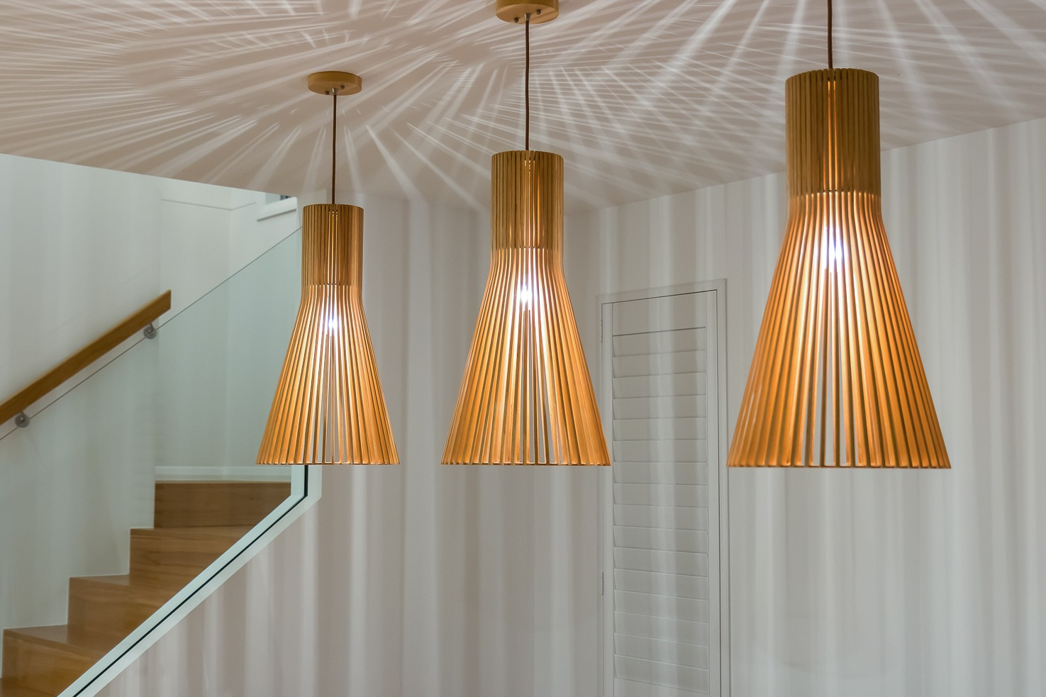 Brisbane Manly contemporary home by evermore close up of feature dining room lights