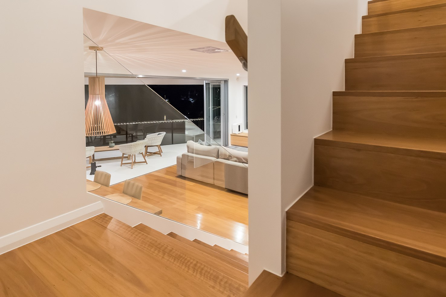 Brisbane Manly contemporary home looking from the stiars into the lounge area